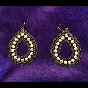 Tear drop earrings with yellow stones.